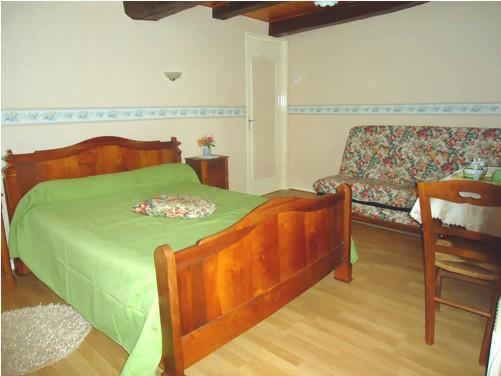 Chambre d'hôte avec un lit double